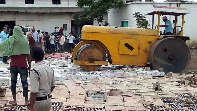 Bulldozer crushed alcohol